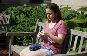 Anna Gregoire, 19, knits outside of Kilachand Hall in Boston, Mass., Tuesday, September 26, 2017.